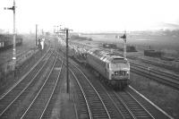 Class 47 no 1107 takes the direct route from Niddrie West to the ECML via Wanton Walls and Monktonhall Junctions on 4 February 1970. The train is the 1358 Bathgate Upper to Ripple Lane empty Cartic 4s.<br><br>[Bill Jamieson&nbsp;04/02/1970]