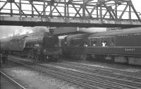 Gresley A3 Pacific no 60110 <I>Robert the Devil</I> speeds south through Doncaster with the 10.10am Waverley - Kings Cross in  September 1962 passing a York - Colchester train standing at the platform. <br><br>[K A Gray&nbsp;01/09/1962]