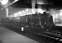Night scene at Carlisle sometime in 1965. Locomotive is Patriot class 4-6-0 no 45531 <I>Sir Frederick Harrison</I> waiting at platform 3 with a northbound train.<br><br>[Robin Barbour Collection (Courtesy Bruce McCartney)&nbsp;//1965]