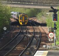 An outer circle train takes the Dunfermline line at Inverkeithing Central Junction on 30 April shortly after leaving Inverkeithing station.<br> <br><br>[Brian Forbes&nbsp;30/04/2010]