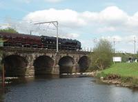<I>The Black Duchess</I>, 6233, heads north over Six Arches bridge at Scorton on 8 May with a Gloucester to Carlisle excursion that she had taken over at Crewe.<br><br>[Mark Bartlett&nbsp;08/05/2010]