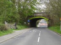 The narrow, low headroom, angled, rail overbridge with entrance to the down side of the former Haigh Station on the Wakefield to Barnsley line on the left. There is periodic impact damage or dislodging of arch stones by over-height vehicles here. M1 J38 is only some 50m behind the camera with through traffic accessing the motorway having increased considerably in recent years.<br><br>[David Pesterfield&nbsp;08/05/2010]