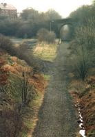 Looking over the site of Skelmanthorpe Station towards Clayton West in March 1988 after standard gauge track had been lifted. This is now part of the route of the 15 inch gauge Kirklees Light Railway.<br><br>[David Pesterfield&nbsp;22/03/1988]