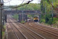 A Liverpool to Blackpool North service photographed through Balshaw Lane road bridge as it calls at Euxton Balshaw Lane station on 8 May 2010. <br> <br><br>[John McIntyre&nbsp;08/05/2010]