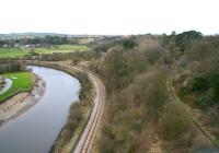 View west from Larpool viaduct on 23 March 2010 showing the Whitby and Pickering Railway running alongside the Esk towards Grosmont. The pathway on the right is the trackbed of the former link via Prospect Hill Junction that climbed steeply from the W&P before swinging north to join the Scarborough - Whitby - Middlesbrough coastal route near Whitby West Cliff station at the northern end of the viaduct. [See image 23574]<br><br>[John Furnevel&nbsp;23/03/2010]