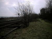 The disused signalbox at Penistone, seen in 2002, viewed from the trackbed of the former Woodhead Route. Route to Huddersfield to the left and straight on to Barnsley (and formerly Sheffield).<br><br>[Ewan Crawford&nbsp;12/03/2002]