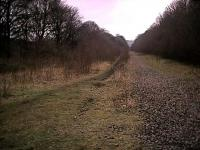 Looking north towards Penistone from just north of Deepcar in 2002. Judging by the remaining ballast here it looks like the southbound track remained after the northbound was lifted.<br><br>[Ewan Crawford&nbsp;12/03/2002]