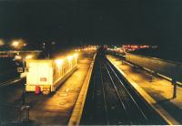Stirling on a frosty evening in January 1995 and a view south from the footbridge which connects the main station with Platforms 9 and 10.  The building on the left did not survive much longer.<br><br>[David Panton&nbsp;05/01/1995]