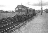 The morning train for Kyle of Lochalsh pulls away from Dingwall in August 1966.<br> <br><br>[Colin Miller&nbsp;/08/1966]