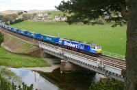 <I>And there's more...</I> Stobart Rail liveried 92017 runs north over the Clyde viaduct at Crawford on 11 May 2010 with a long, long train of Tesco containers.<br><br>[John Furnevel&nbsp;11/05/2010]