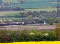A Freightliner class 66 waits at signals by a barren section of Healey Mills yard with loaded coal wagons on 14 May 2010. Healey Mills TMD is located off picture to the right.<br><br>[David Pesterfield&nbsp;14/05/2010]
