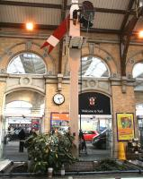Main entrance hall at York station on 21 March 2010. The plaque reads: <i>This 19th century North Eastern Railway distant signal, one of the last  in use on a passenger line, was taken out of service in 1984. Signals of this type on former NER routes were painted red until after 1928, so it has been restored to its original condition and placed here as a memento of York's railway heritage, with assistance from the NER association.</i> <br> <br><br>[John Furnevel&nbsp;21/03/2010]