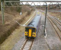 A 153 unit on a Preston to Ormskirk service has just joined the single line at Farington Curve Junction on 13 March 2010. The tracks on the right lead to Lostock Hall and East Lancashire while the WCML can be seen in the background. <br> <br><br>[John McIntyre&nbsp;13/03/2010]