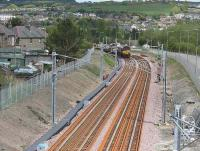 A DBS class 66 on the rear of a PW train stands on the new down line on 17 May 2010 after delivering CWR. View from Whitburn Road bridge back towards Bathgate. <br><br>[James Young&nbsp;17/05/2010]