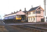 An afternoon train from New Holland Pier to Cleethorpes stands at New�Holland Town on 14 December 1974.