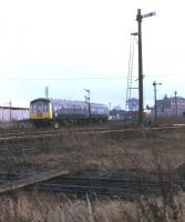 A DMU for Cleethorpes heads south east away from New Holland Town in December 1974.