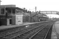 The distinctive signal box and substantial station building at Grantown-on-Spey West, still extant in April 1968, three years after closure - but alas now long gone.<br><br>[David Spaven&nbsp;/04/1968]