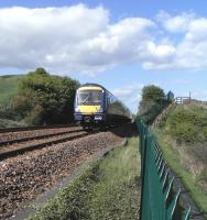 170 393 passes the site of the junction for Seafield Colliery with a southbound service on 15 May 2010 [see image 29016]<br><br>[David Panton&nbsp;15/05/2010]
