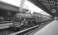 Black 5 no 44794 bides its time with the 5.50pm Dunblane service waiting to leave Glasgow's Buchanan Street station in July 1966.<br><br>[K A Gray&nbsp;26/07/1966]