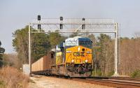 Heading south west out of Maxwell Yard, Greenwood, South Carolina on 23 March 2010 are ES44AH 738 and CW44AC 299. The locomotives are hauling coal empties destined for the CSX yard at Tucker, Georgia.<br><br>[Andy Carr&nbsp;23/03/2010]