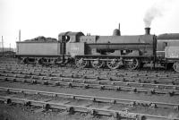 G2 0-8-0 no 49454 photographed at Speke Junction (8C) in September 1958 having probably worked into the area on a freight from its home depot of Crewe South. Speke Junction closed to steam in May 1968 and the old 12 road straight shed is long demolished. Sidings still remain on part of the site which is now bordered on the south side by the large <I>New Mersey</I> shopping complex.<br><br>[Robin Barbour Collection (Courtesy Bruce McCartney)&nbsp;26/09/1958]