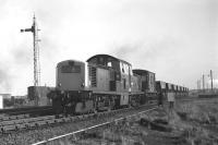 Clayton no D8608 shunts ballast hoppers at Niddrie West in February 1970.<br> <br><br>[Bill Jamieson&nbsp;04/02/1970]