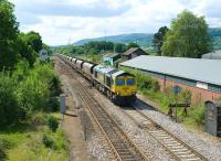 Freightliner 66957 with a northbound coal train from Portbury import terminal, about to pass through Abergavenny on 27 May 2010.<br><br>[Peter Todd&nbsp;27/05/2010]