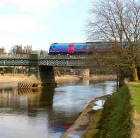 Immediately after leaving York station, the 1347 Liverpool Lime Street - Scarborough service turns east and crosses the River Ouse. View is south along the river on a pleasant 21 March 2010, with part of York Minster visible in the left background. <br> <br><br>[John Furnevel&nbsp;21/03/2010]