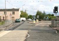 The site of Glasgow Road level crossing in Bathgate in May 2010,  some 40 years on from the recent mystery photograph [see image 29153]. The site is now a roundabout, seen here from Menzies Road, with the building on the left providing the link with the 1970 image. While chimneys, windows and doors have all been subject to modification the distinctive roof line remains. The sign on the building today is that of a West Lothian Council adult learning centre.      <br> <br><br>[John Furnevel&nbsp;30/05/2010]