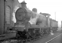 Pickersgill 0-6-0 no 57679 stands alongside the main shed building at 64C Dalry Road on a grey looking 3 January 1958. The compact former Caledonian shed, always overshadowed by its larger city neighbours, was officially closed in October 1965 and demolished a short time thereafter. The site is now part of Edinburgh's Western Approach Road. <br><br>[Robin Barbour Collection (Courtesy Bruce McCartney)&nbsp;03/01/1958]