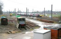A CrossCountry service runs north through the site of Tollerton station in the Vale of York on 25 March 2010. Nothing remains of the station, which closed to pasengers in 1965, but the site sees regular use nowadays by engineering and maintenance staff. [See image 28270] <br><br>[John Furnevel&nbsp;25/03/2010]