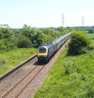 A First Great Western HST northbound through the disused Oaksey station (closed 1964) on the Swindon - Gloucester line in June 2010. It is hoped this route will be returned back to double track by 2015.<br> <br><br>[Peter Todd&nbsp;03/06/2010]