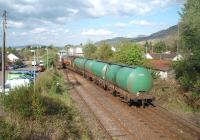 Having waited alongside the Mallaig line for a Glasgow bound Sprinter to clear the section, [See image 29132] 66099 propels four empty fuel tanks back to the Fort William Junction signal so that it can follow the passenger train south. <br><br>[Mark Bartlett&nbsp;18/05/2010]