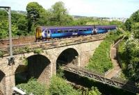 An Edinburgh Waverley - Glasgow Central via Shotts train about to cross the Water of Leith on Slateford Viaduct on a very warm and sunny 3 June 2010. The 1237 stopping - service has just left Slateford station, with its next scheduled call, Kingsknowe, almost in sight.  <br> <br><br>[John Furnevel&nbsp;03/06/2010]