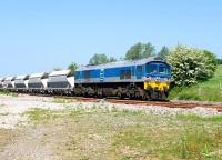 Foster Yeoman 59002 with an eastbound stone train passing Crofton on 4 June.<br> <br><br>[Peter Todd&nbsp;04/06/2010]