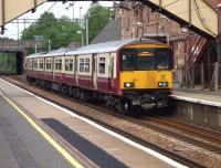 Partick bound 318 270, awaiting departure from Uddingston on 2 June 2010.<br><br>[John Steven&nbsp;02/06/2010]