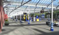 A general view from under the canopy at Kilmarnock on 3 June.� The <br> ironwork has recently been repainted in 'Scotland's Railway' colours.�Very fresh and smart, but not quite as warm as the previous SPT colour scheme with gold highlighting.� The four cars at Platform 1, which have just arrived from Glasgow, are in the process of being split into two with the front set destined for Stranraer after a wait of 15 minutes or so. <br> <br><br>[David Panton&nbsp;03/06/2010]