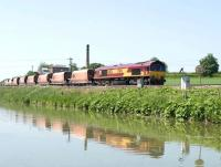 66124 with an eastbound stone train passing Crofton pumping station on 4 June 2010.<br><br>[Peter Todd&nbsp;04/06/2010]