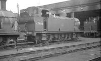'Jinty' no 47490 standing on Sutton Oak shed (8G), St Helens, in 1962. Sutton Oak was officially closed in 1967 with the former 10 road straight shed being subsequently converted for use as a supermarket.<br><br>[K A Gray&nbsp;15/04/1962]