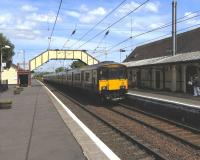 A 6-car 318 arrives at Prestwick Town on 3 June with a service for Ayr.<br><br>[David Panton 03/06/2010]
