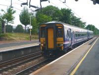 Glasgow Central - Edinburgh Waverley service, formed by 156446, passing through Uddingston on 2 June 2010. <br><br>[John Steven&nbsp;02/06/2010]