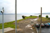 Standing on the station footbridge at Craigendoran in light rain on 8 June 2010. Photograph looking west over the site of the former pier platform and beyond across the Clyde towards Gourock. [See image 24286]<br> <br><br>[John Furnevel&nbsp;08/06/2010]
