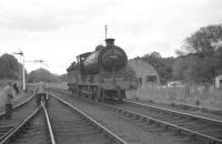 64624 in the process of running round the RCTS <I>Borders Railtour</I> at Jedburgh on 9 July 1961. The J37 had brought the train from Hawick along wth NBR 256 <I>Glen Douglas</I>, following which the special visited various branches before the pair handed over to no 60143 at Tweedmouth [see image 27903] for the journey south to Newcastle.<br><br>[K A Gray&nbsp;09/07/1961]