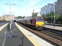 67 025 arrives at Haymarket platform 2 on a sunny 4 June 2010 with the evening loco-hauled Fife Outer Circle service.<br><br>[David Panton&nbsp;04/06/2010]