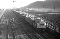 EE Type 4 no 266 approaches Niddrie West Junction with an unidentified fitted freight from Millerhill Yard in February 1970. The direct route to Monktonhall Junction and the ECML via Wanton Walls Jct is on the left and Newcraighall (Klondyke) Colliery stands in the background. <br><br>[Bill Jamieson&nbsp;04/02/1970]