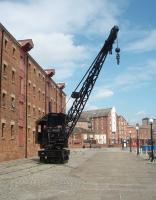 The old warehouses at Gloucester Docks are now used by businesses, retail outlets and the local authority. Behind the North Warehouse is a short length of the old dock railway and this preserved Joseph Booth rail mounted steam crane, built at Leeds in 1944, and with a seven and a half ton lifting capacity.  <br><br>[Mark Bartlett&nbsp;11/06/2010]