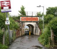 Entrance to Craigendoran station from Dennistoun Crescent on the north side of the line in June 2010. The tunnel passes below the West Highland tracks and opens out onto the station's remaining operational platform. The Clyde can be seen beyond. <br><br>[John Furnevel&nbsp;08/06/2010]