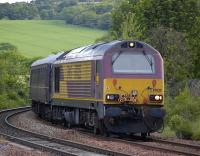 67025 rounds the curve at Inverkeithing Central Junction with an SRPS excursion from Glenrothes to Liverpool on 12 June.� 67030 provided the tail lamp!<br> <br><br>[Bill Roberton&nbsp;12/06/2010]