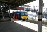 A Manchester Airport - Newcastle Central service calls at York's outside platform 11 on 21 March 2010. The stairway on the right leads to the west side station car park and across Leeman Road to the National Railway Museum. <br><br>[John Furnevel&nbsp;/03/2010]