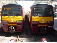Basking in the sun at Helensburgh on 12 June 2010, units 320303 and 320319 at the buffer stops. <br><br>[John Steven&nbsp;12/06/2010]